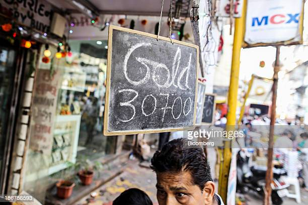 Gold prices are displayed on signs during the festival of Dhanteras two days before Diwali in the Zaveri Bazaar area of Mumbai India on Friday Nov 1...