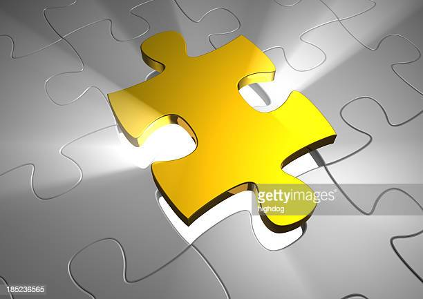 Gold puzzle piece rising above grey pieces