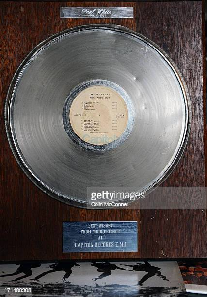 A gold record of twist and shout that hangs on Pauls wallPaul Whiteretired Capitol Records executive who introduced the Beatles song Love me Do to...