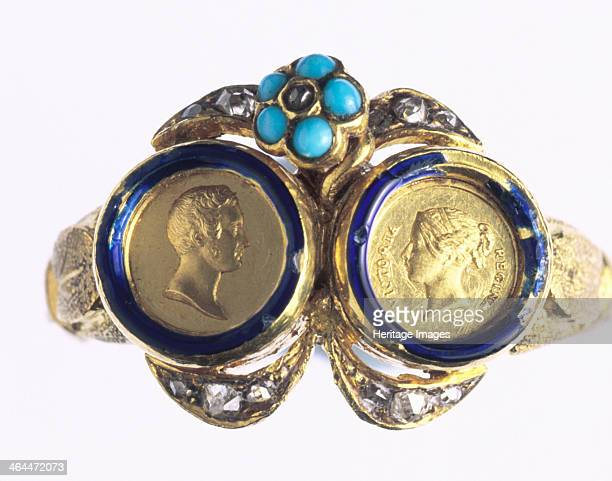 A gold ring with portraits of Queen Victoria and Prince Albert 1840 The bezel is formed of miniature medals of Victoria and Albert It was made by...