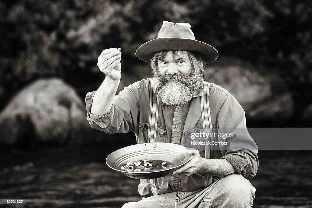 Gold rush prospector showing off his nuggets