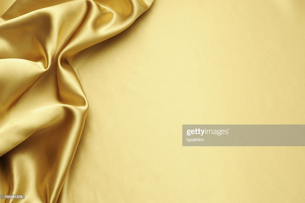 Gold satin texture background with copy space : Stock Photo