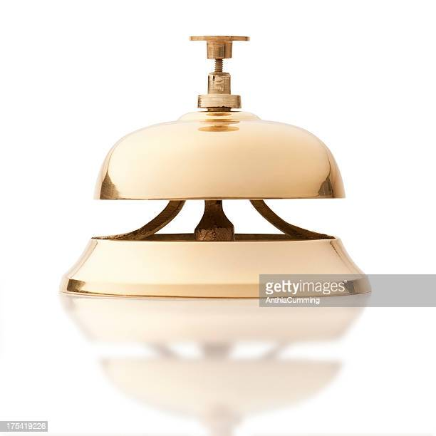 Gold service bell isolated on white background