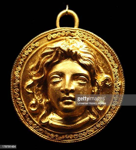 Gold shieldshaped pendant with female head possibly Medusa 200150 BC