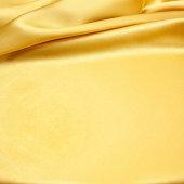 Gold silk satin background textured