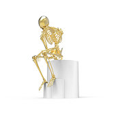 Gold skeleton sitting pose