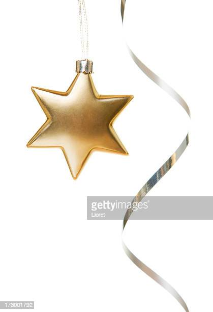 Gold star ornament with silver ribbon on white background