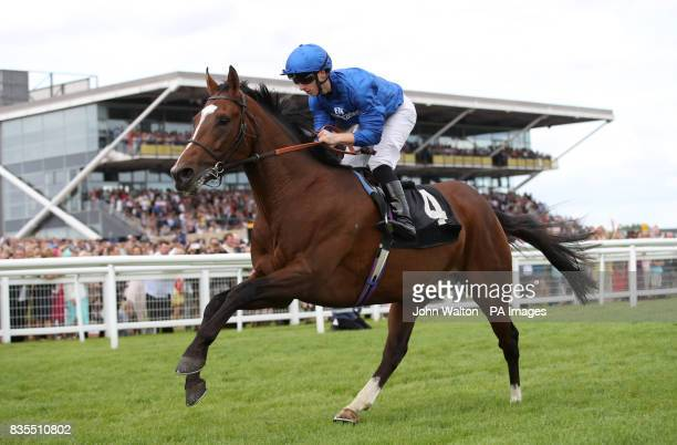Gold star ridden by Edward Greatrex comes home to win The Betfred Proud To Work With Simpson Group EBF Maiden Stakes at Newbury Racecourse