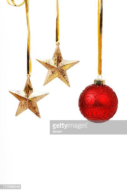 Gold stars and red bauble hanging from gold ribbon