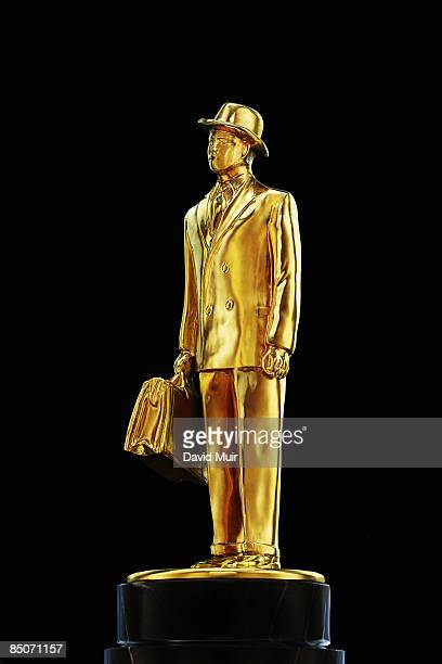 gold statue of a business man