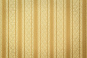 Antique style striped gold wallpaper
