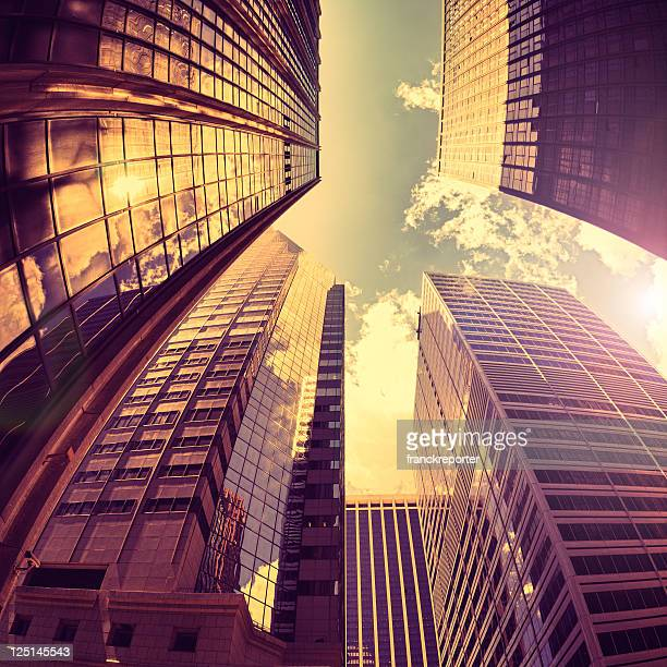 Gold tall Manhattan skyscraper against Sun