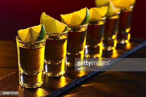 Gold tequila with lime : Stock Photo