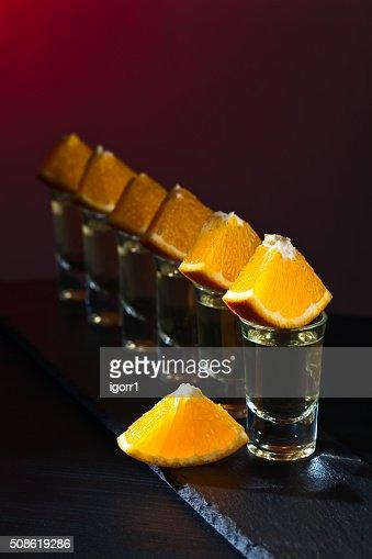 Gold tequila with orange : Stock Photo