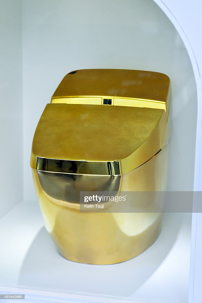 A gold toilet is displayed during the 'Toilet!? Human Waste and Earth's Future' exhibition at The National Museum of Emerging Science and Innovation - Miraikan on July 1, 2014 in Tokyo, Japan. The exhibition focuses on how the toilet has changed our daily lives and discovers what the most environment-friendly and ideal toilet is.