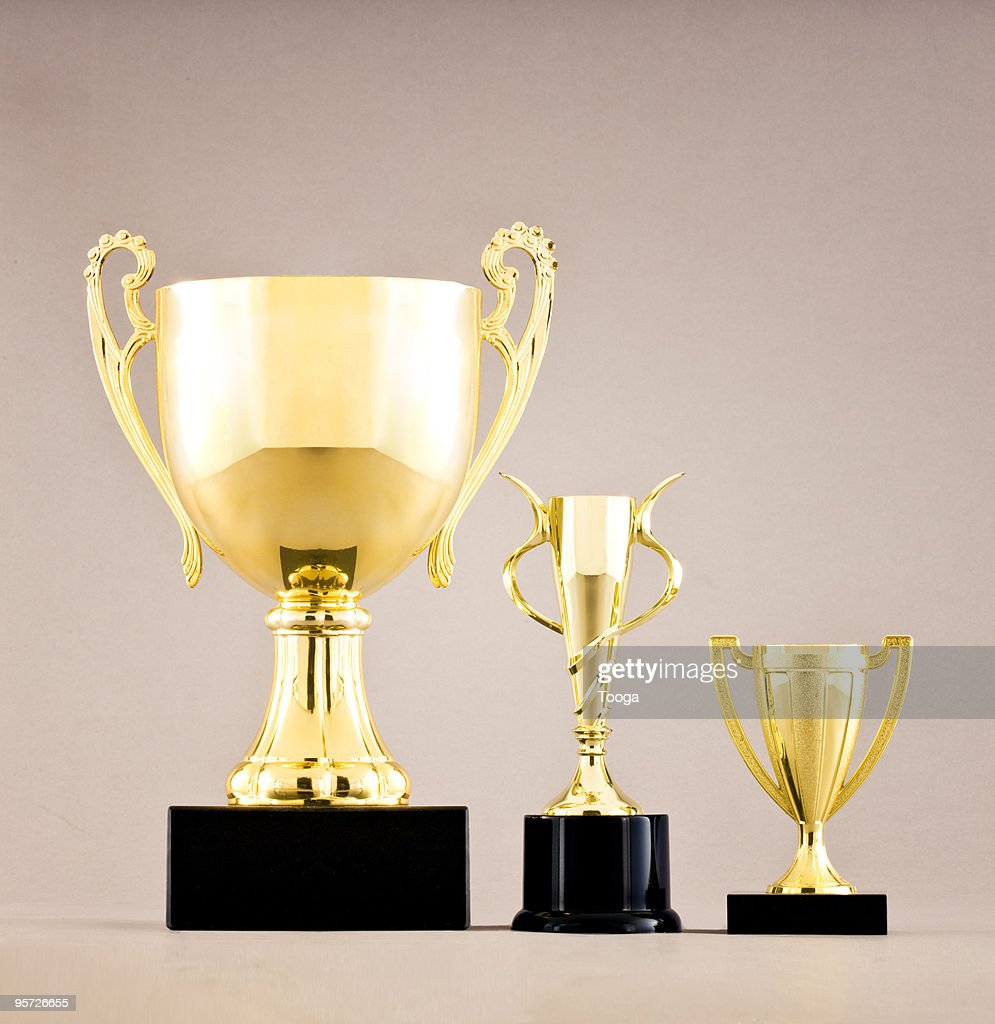 Gold trophies in different sizes