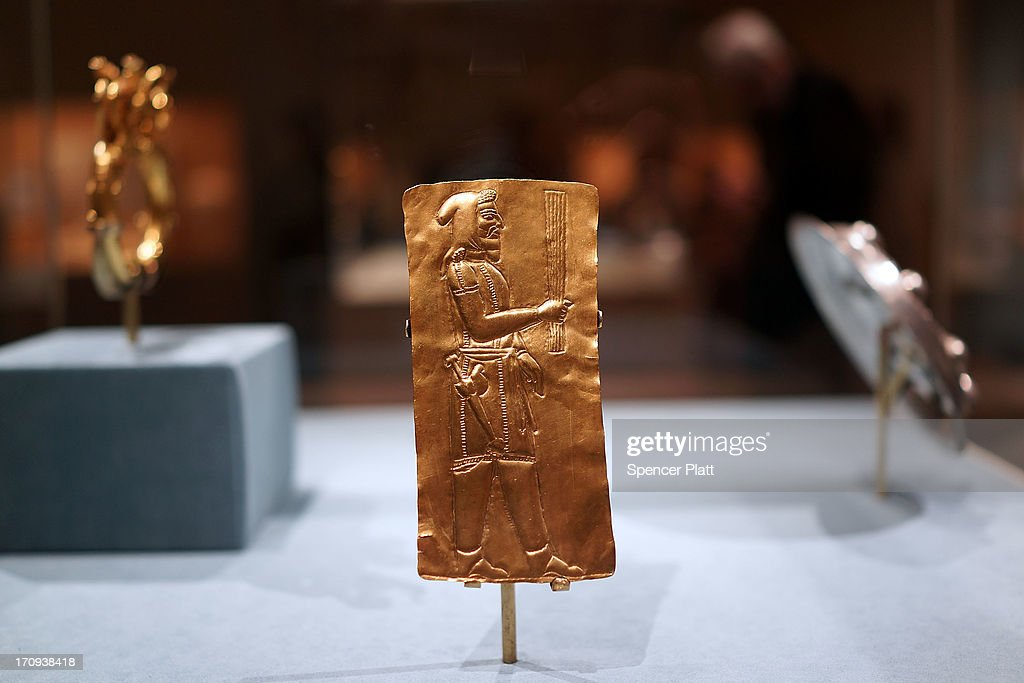 A gold Votive plaque showing a priest is viewed at the traveling exhibition The Cyrus Cylinder and Ancient Persia: Charting a New Empire at The Metropolitan Museum of Art on June 20, 2013 in New York City. One of the most famous surviving icons from the ancient world, the Cyrus Cylinder is the centerpiece of the traveling exhibition The Cyrus Cylinder and Ancient Persia: Charting a New Empire.