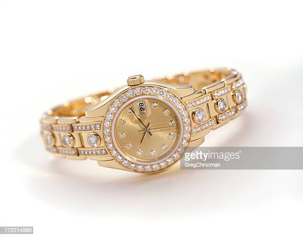 A gold watch with embedded diamonds