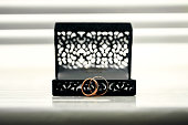Gold wedding rings and a black lace box