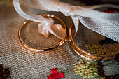 gold wedding rings closeup on the fabric in a vintage rustic style