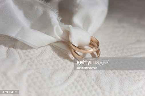 Gold Wedding Rings Tied With A Strip Of Cloth Stock Photo Thinkstock
