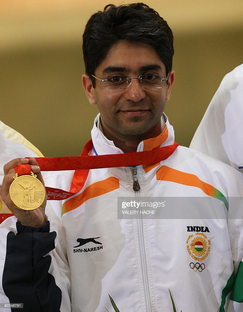 Gold winner Abhinav Bindra of India holds his medal on the podium following the men's 10m air rifle shooting finals for the 2008 Beijing Olympic...