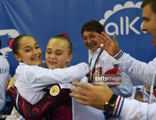 Gold winner Angelina Melnikova and Elena Eremina of Russia celebrate after winning the women's floor event of the apparatus final at the European...