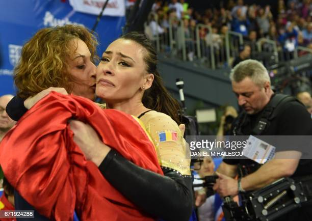Gold winner Catalina Ponor of Romania celebrate winning the balance beam of the apparatus final at the European Artistic Gymnastics Championship in...