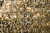 Golden background mosaic with light spots