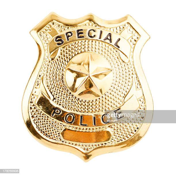 A golden badge saying special police
