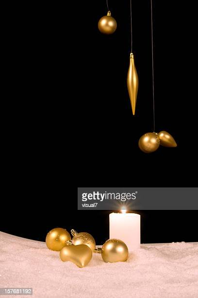 golden baubles, xmas ornaments with snowflakes and candle
