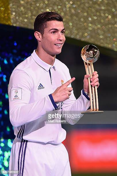 Golden Boot winner Cristiano Ronaldo of Real Madrid holds the trophy after the FIFA Club World Cup final match between Real Madrid and Kashima...