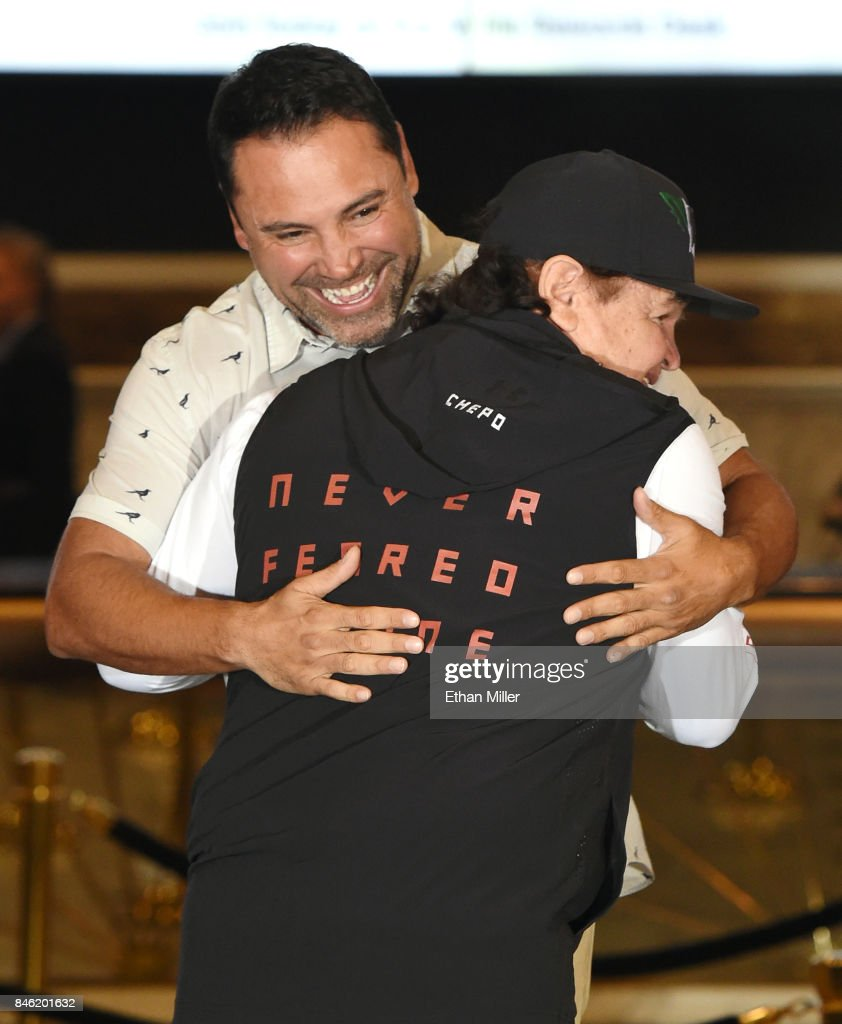 Golden Boy Promotions Chairman and CEO Oscar De La Hoya (L) greets Canelo Alvarez's manager/trainer Jose 'Chepo' Reynoso as he arrives at MGM Grand Hotel & Casino on September 12, 2017 in Las Vegas, Nevada. Alvarez will challenge WBC, WBA and IBF middleweight champion Gennady Golovkin for his titles at T-Mobile Arena on September 16 in Las Vegas.