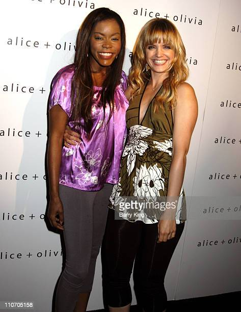 Golden Brooks and Mena Suvari during Alice Olivia Boutique Opening Arrivals at Alice Olivia Boutique in Los Angeles CA United States