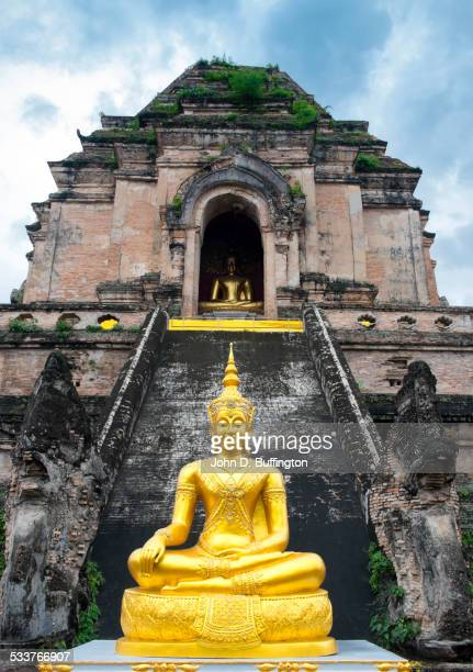 Golden Buddha statue outside ornate temple, Chiang Mai, Chiang Mai Province, Thailand