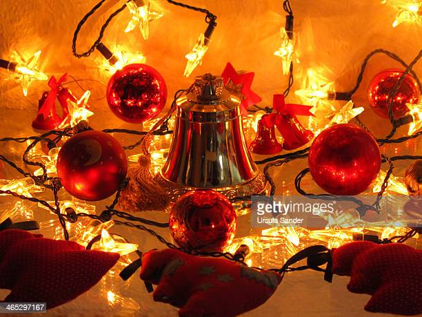 Golden Christmas bell and red Christmas balls
