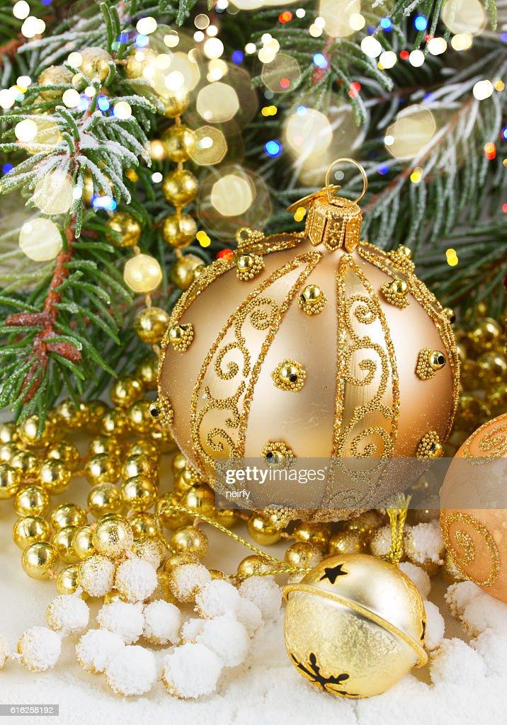 golden christmas bow and evegreen tree : Stock Photo