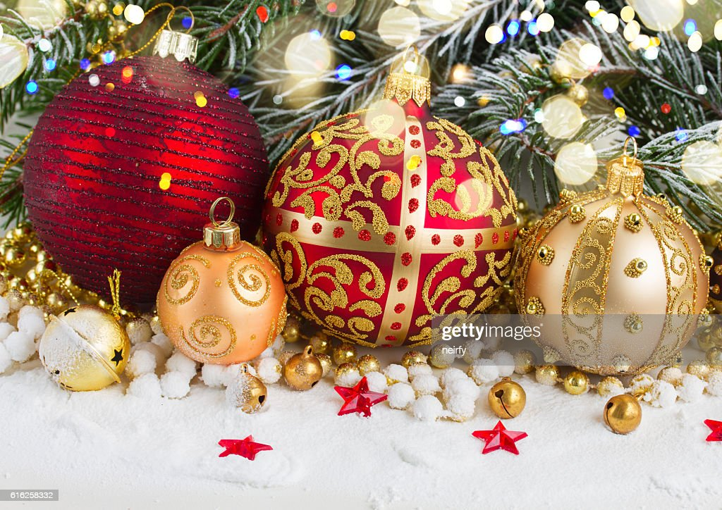 golden christmas bow and evegreen tree : Stock Photo