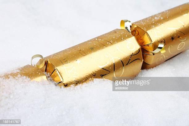 Golden Christmas Cracker in Snow