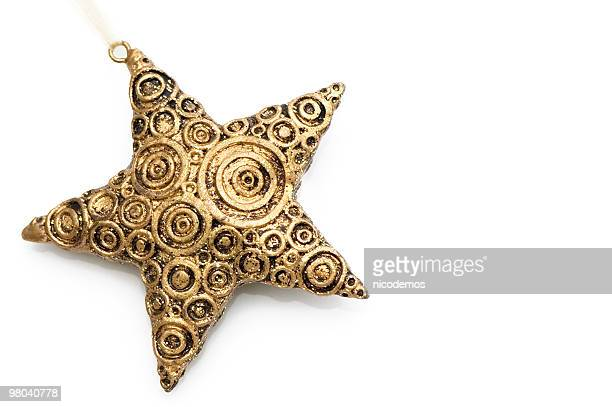 Golden Christmas star decoration with swirls on white