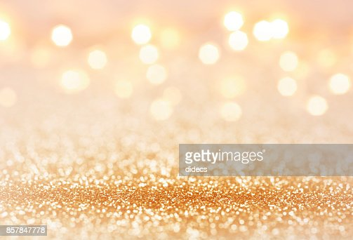 Golden color abstract glitter texture background for holidays : Stock Photo