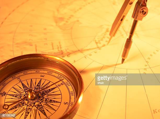 Golden compass on a map with protractor