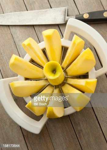 Golden Delicious apple in apple slicer : Stock Photo