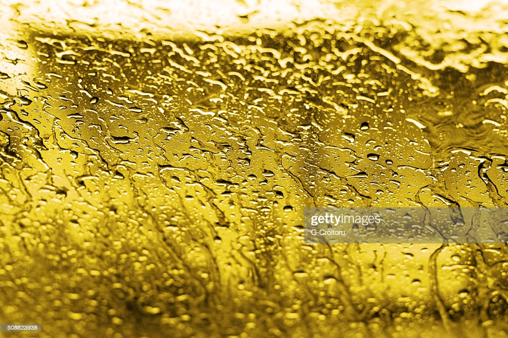 Golden drops on the glass. : Stock Photo