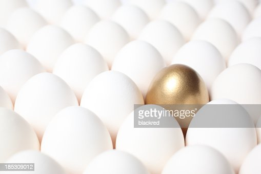 Golden Egg Standing Out from a Crowd of Ordinary Eggs