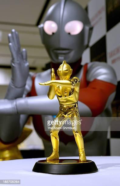 A golden figure of Japanese television series 'Ultraman' is displayed at Shinjuku Takashimaya department store on Octber 24 2013 in Tokyo Japan The...