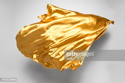 golden flying fabric : Stock Photo