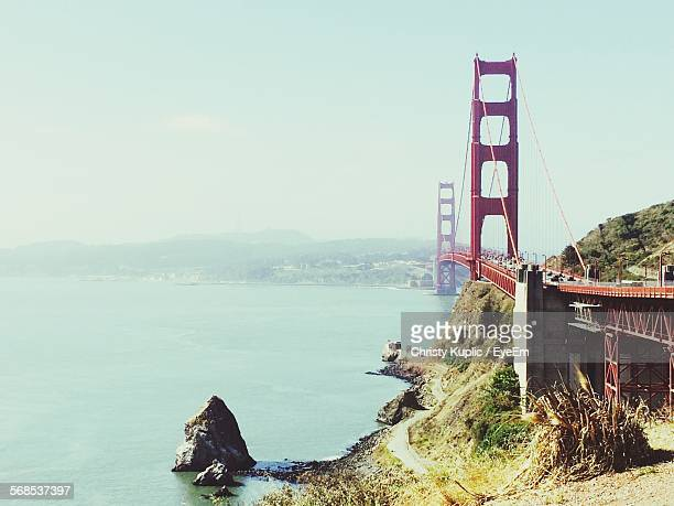 Golden Gate Bridge By Sea Against Sky In City