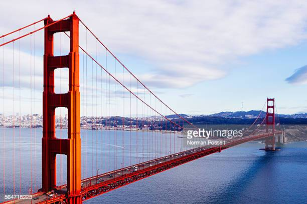 Golden Gate Bridge over San Francisco Bay against cloudy sky
