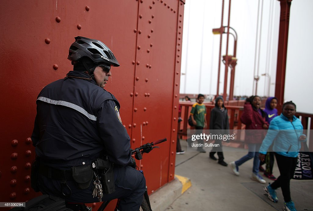 A Golden Gate Bridge patrol officer monitors activity on the Golden Gate Bridge on June 27, 2014 in San Francisco, California. The Golden Gate Bridge district's board of directors voted unanimously to approve a $76 million funding package to build a net suicide barrier on the iconic span. Over 1,500 people committed suicide by jumping from the iconic bridge since it opened in 1937. 46 people jumped to their death in 2013.